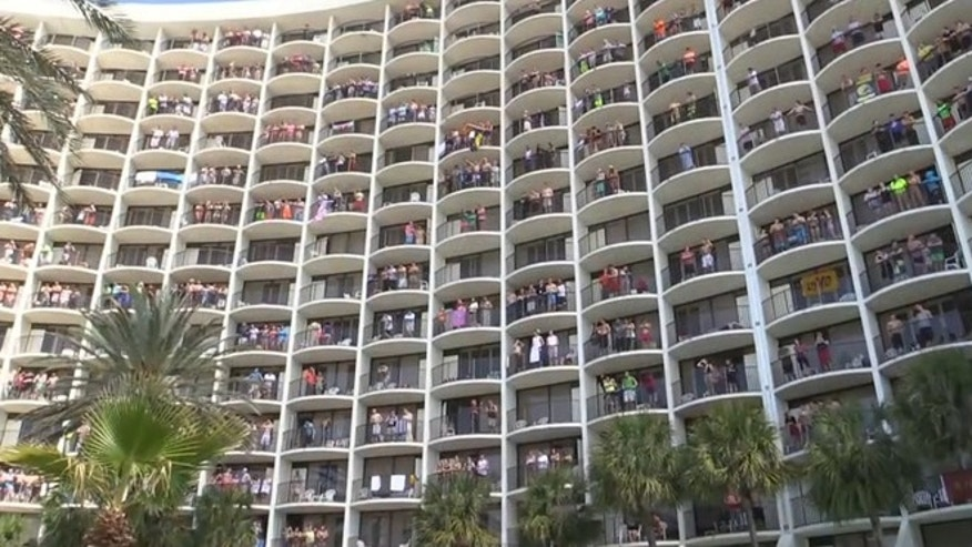 Dozens of hotel guests greet the day to an iconic animated movie song.