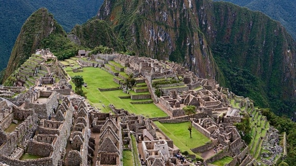 "Machu Picchu (Quechua: Machu Picchu) – ""Old Mountain"", is a pre-Columbian Inca  site located 2,430 metres (7,970 ft) above sea level. It is situated on a mountain ridge above the Urubamba Valley in Peru, which is 80 kilometres (50 mi) northwest of Cuzco and through which the Urubamba River flows. Most archaeologists believe that Machu Picchu was built as an estate for the Inca emperor Pachacuti  (1438–1472). Often referred to as ""The Lost City of the Incas"", it is perhaps the most familiar icon of the Inca World. Machu Picchu was declared a Peruvian Historical Sanctuary in 1981 and a UNESCO World Heritage Site in 1983. Since it was not plundered by the Spanish when they conquered the Incas, it 