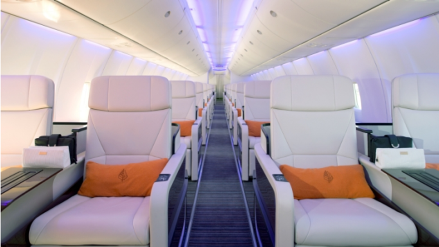 Plush seats on the new Four Seasons branded private jet.