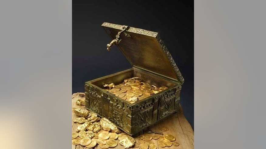This undated photo provided by Forrest Fenn shows a chest purported to contain gold dust, hundreds of rare gold coins, gold nuggets, and other artifacts.
