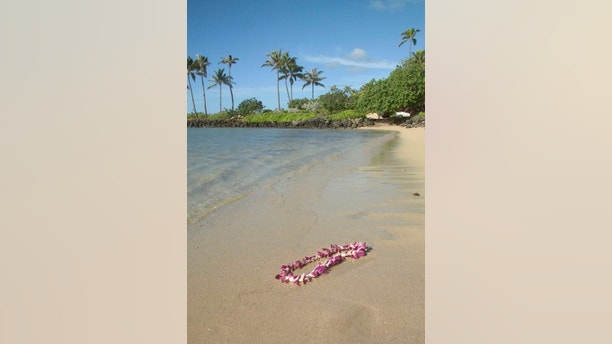 Garland of flowers washed up on the beach