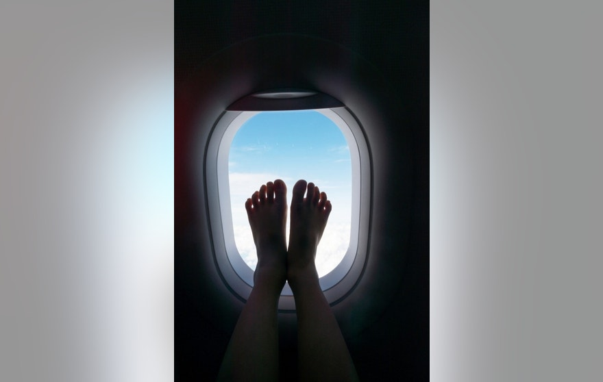 feet touched the airplane window