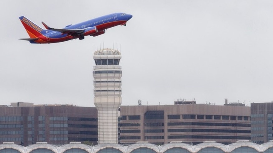 FILE - In this Sept. 25, 2014 file photo, a Southwest Airlines jet takes off from Washington's Ronald Reagan National Airport. (AP Photo/J. Scott Applewhite, File)