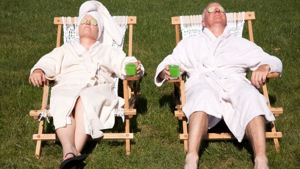 Mature couple detoxing during a do it yourself spa day in their backyard