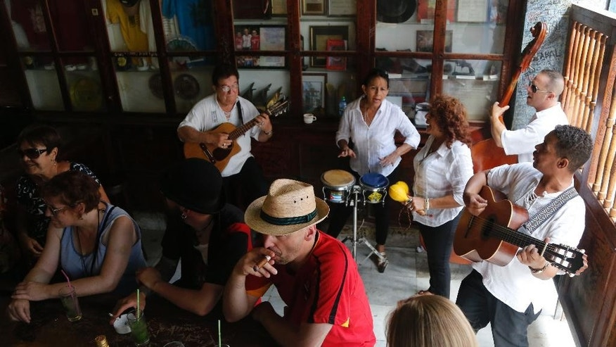 May 24, 2015:  Tourists enjoy cigars, mojitos and live music at the Bodeguita del Medio Bar, frequented by the late American novelist Ernest Hemingway in Old Havana, Cuba.