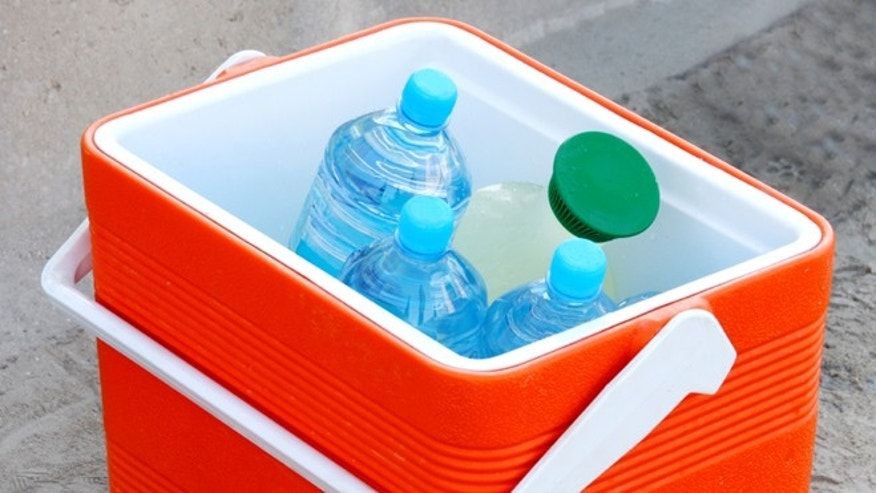 Cool box containing water bottles and juice