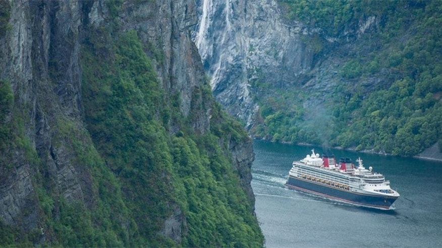 The Disney Magic arrives in Geiranger, Norway, for the first time, sailing through the UNESCO World Heritage Site of Geirangerfjord.