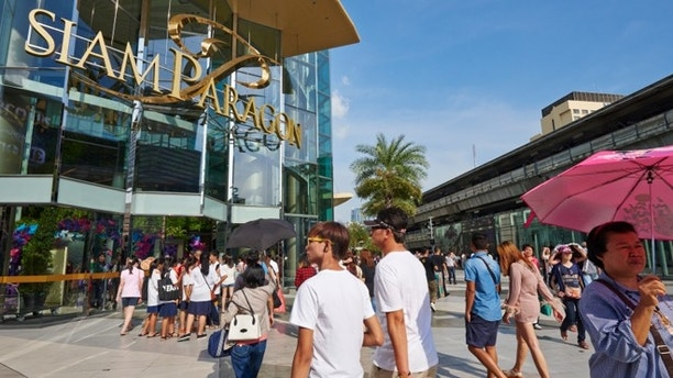 Bangkok, Thailand - September 20, 2014: customers entering at Siam Paragon, a luxury shopping mall located in Pathum District. Bangok. Thailand.