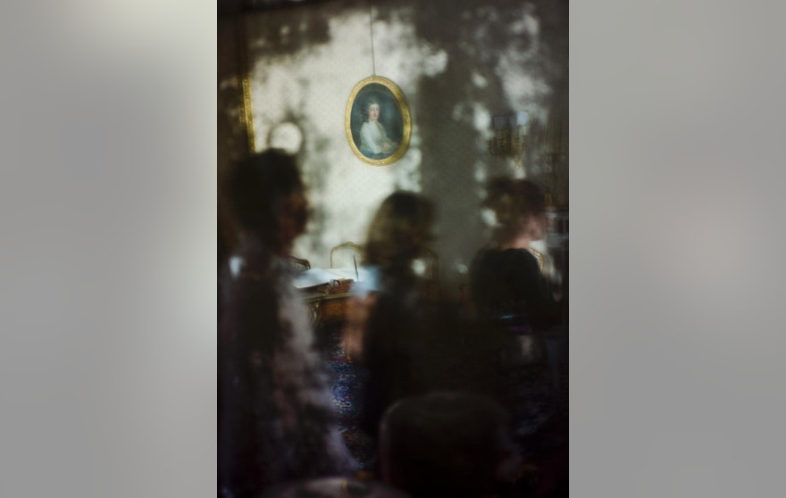July 9, 2015: Visitors are reflected by a mirror in the Napoleonic Apartments inside the Quirinale Presidential Palace in Rome.