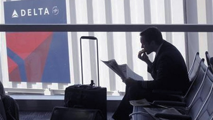 Can Delta woo business travelers with its on-time arrival record?