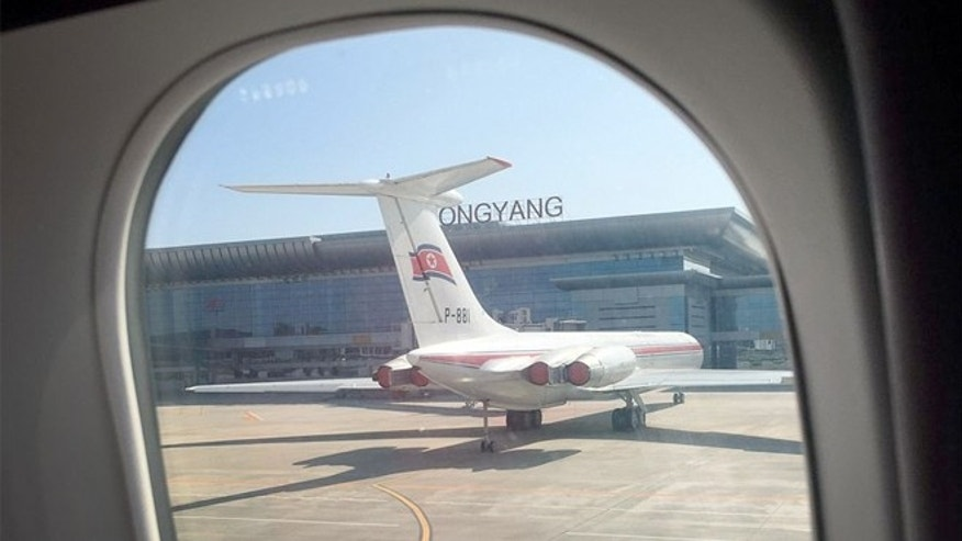 An Air Koryo plane sits on the tarmac in front of the new Pyongyang International Airport terminal building, in Pyongyang, North Korea.