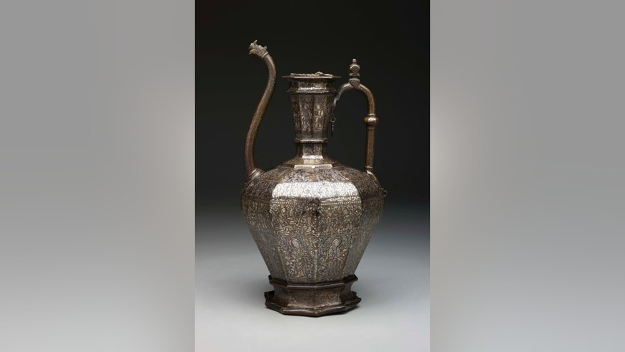 "This image provided by the Dallas Museum of Art shows The ""Homberg Ewer,"" a brass inlaid with silver vase from Syria. A new show at the Dallas Museum of Art features works from a rarely-exhibited private collection of Islamic art. The exhibit features more than 50 works from the Keir Collection, which has started arriving in Dallas this year on a 15-year loan. (The Keir Collection of Islamic Art on loan to the Dallas Museum of Art, via AP)"