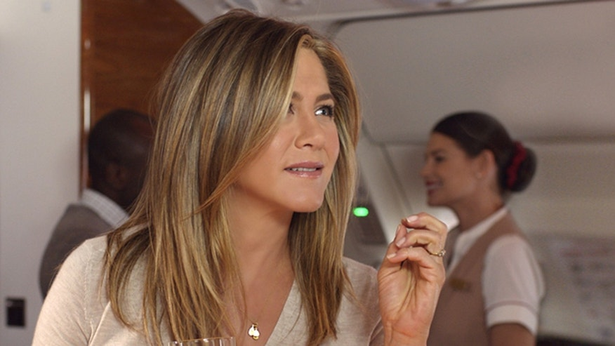 Jennifer Aniston enjoys a drink in the plane's Business bar.