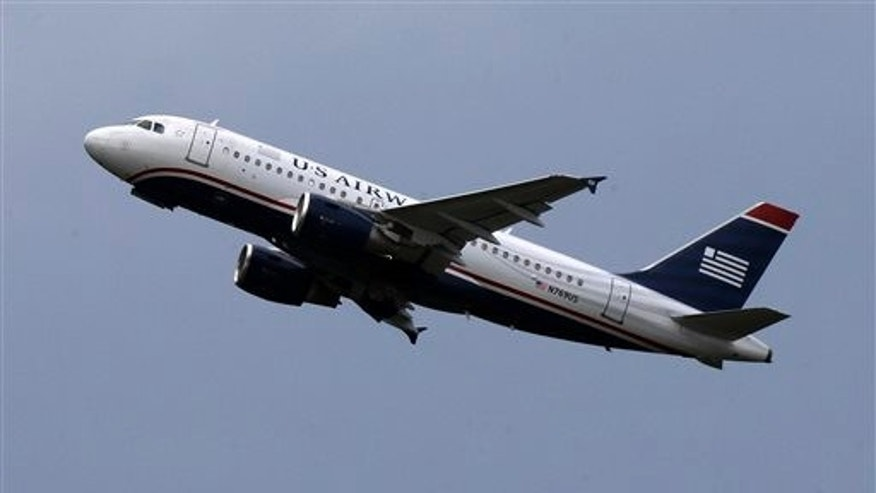 In this July 23, 2013, file photo US Airways jet takes off from Pittsburgh International Airport in Imperial, Pa.