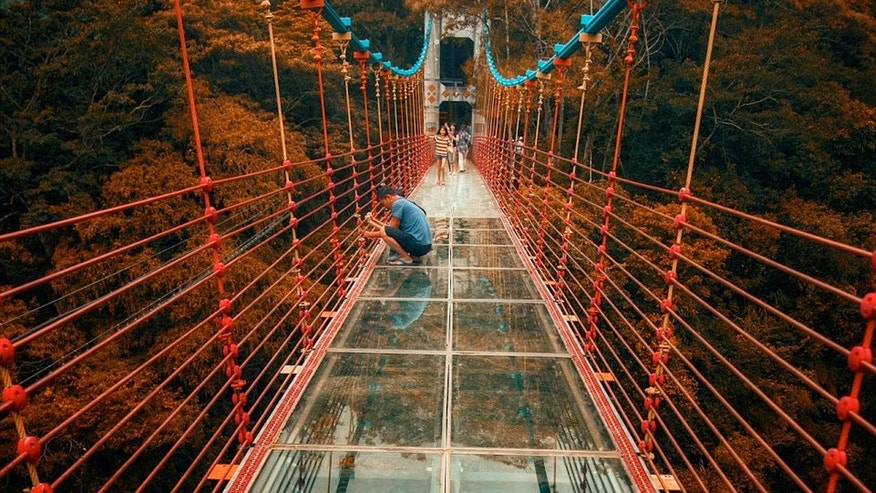 A new glass-bottomed bridge has become an instant hit with thrill-seeking tourists after opening in Nantou, Taiwan/