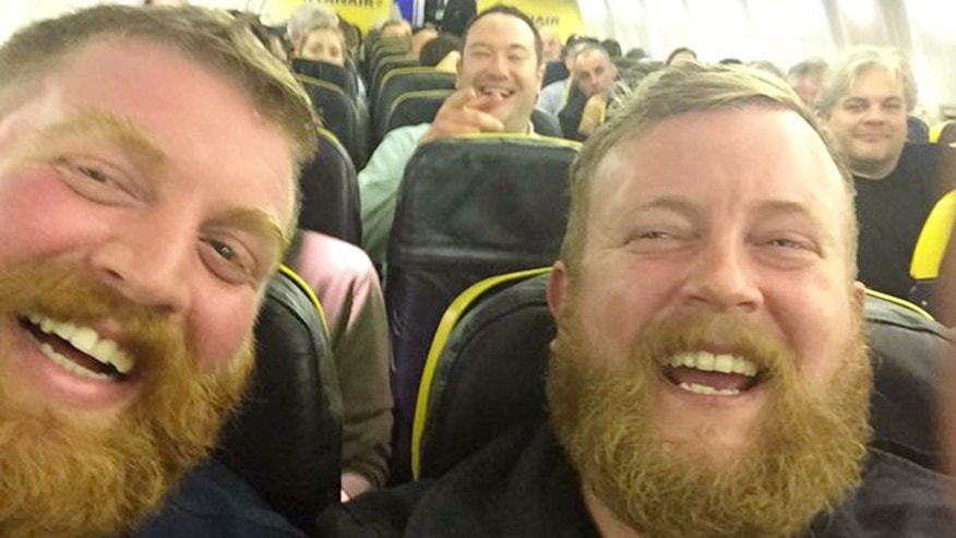 A chance meeting of two bearded men just before takeoff.