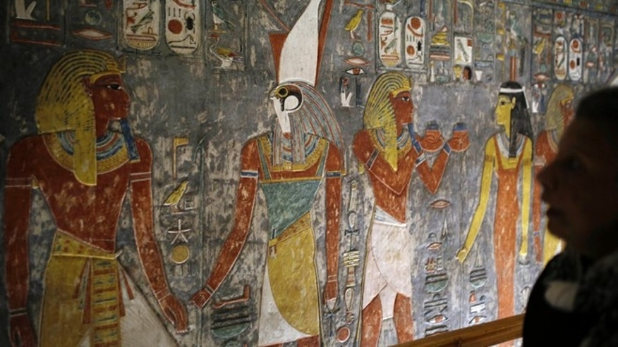Nov. 5, 2015: A visitor looks at colored carvings on a wall at the Horemheb tomb, the last pharaoh of the 18th Dynasty of Egypt, in the Valley of the Kings in Luxor, Egypt.