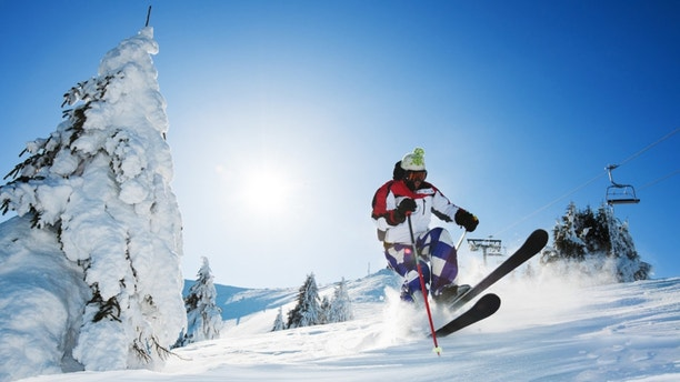 Young skier enjoying while skiing in the mountains. 