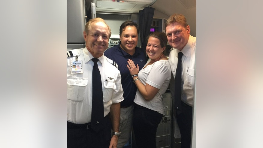 Rebecca Eltzroth and Sam Lockard with the American Airlines captain and co-pilot.  The picture was taken after the plane had landed.