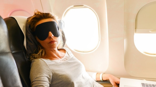 Mature Woman having nap in a plane