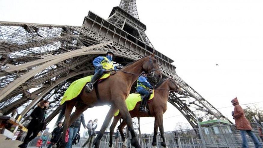 Police keep watch at Paris' Eiffel Tower.