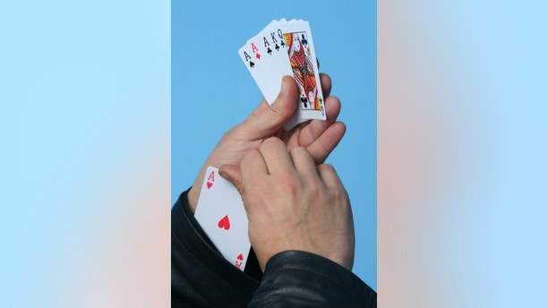 Gambling and cheating. Ace of hearts from the sleeve