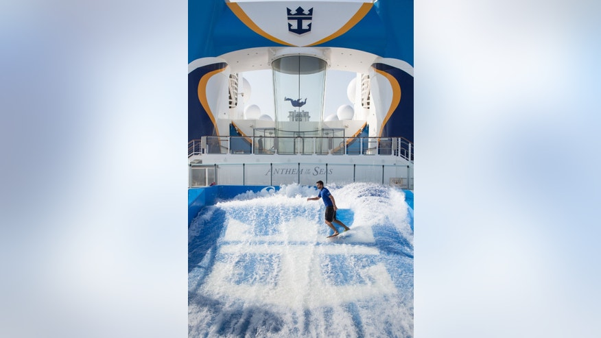 Surfing on the Anthem of the Seas, with the iFly in the background.