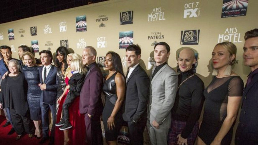 The cast of American Horror Story: Hotel pose at the premier of the show's fifth season.
