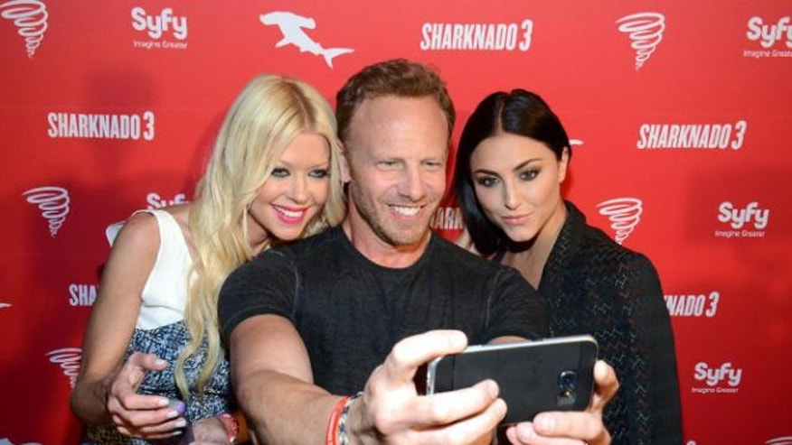 July 10, 2015: Ian Ziering (center), withTara Reid and Cassie Scerbo at Syfy's Sharknado 3 Party at Hotel Solamar in San Diego, Calif.