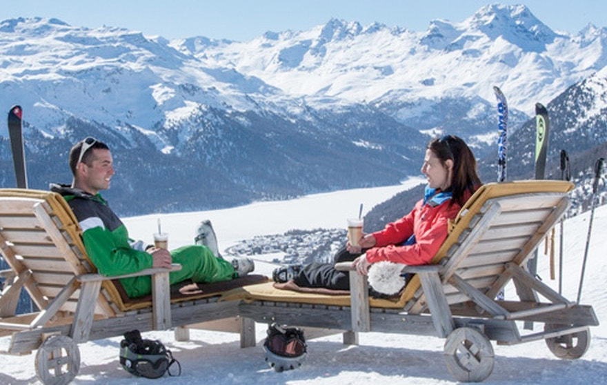 Winter tourism in the Swiss Alps means catch rays after a day of skiing.