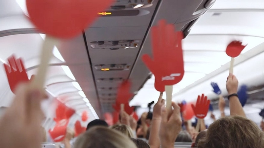 On a JetBlue flight from Boston to Phoenix, the airline filmed a commercial offering each of the 150 passengers a free roundtrip ticket to any destination in the world --if they could compromise.