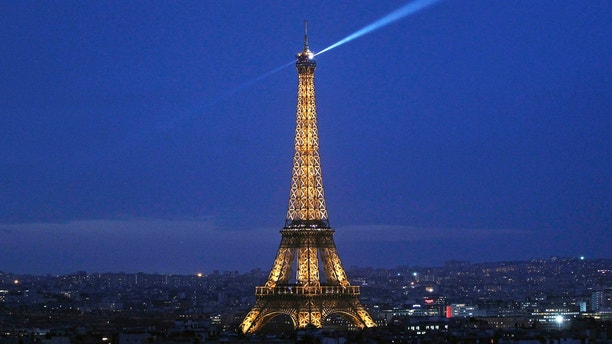"""PARIS, FRANCE - DECEMBER 21:  The Eiffel Tower by night is seen from the """"Arc de triomphe"""" on December 21, 2015 in Paris, France. Tourists from around the world will visit the Champs-Elysees, Eiffel tower, department stores, and surrounding neighborhoods to enjoy the magic of the end of year illuminations. (Photo by Chesnot/Getty Images)"""
