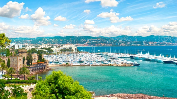 Mediterranean landscape with cloudy blue sky. View of sea and luxury resort of Cote d'Azur in France. French riviera