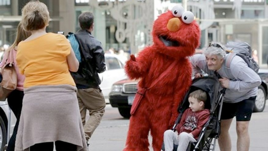 New York City is considering regulating the costumed characters that greet tourists in Times Square.
