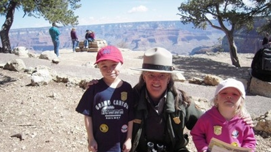 Ethan Sitzman and his sister Hannah with a park ranger at Grand Canyon. Part of the Junior Ranger program.