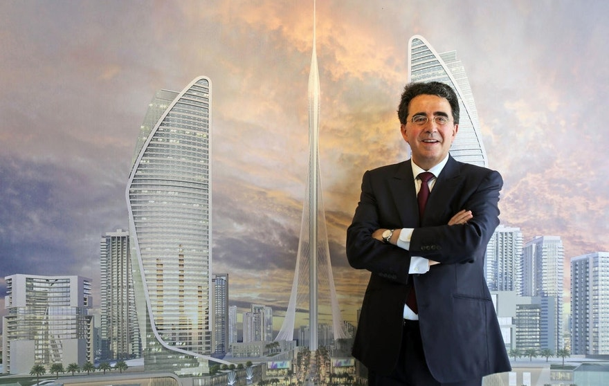 Spanish-Swiss architect Santiago Calatrava Valls poses in front of a rendering of his project during a press conference in Dubai, United Arab Emirates, Sunday, April 10, 2016. Dubai is reaching for the sky once again, with the developer of its world's tallest building vowing Sunday to build an even taller tower bedecked with rotating balconies and elevated landscaping inspired by the mythical hanging gardens of Babylon. (AP Photo/Kamran Jebreili)