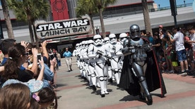 At various times each day, the menacing Captain Phasma leads a squad of First Order stormtroopers as they march in formation from <em>Star Wars</em> Launch Bay to the Center Stage area at Disney's Hollywood Studios in an intimidating demonstration of the First OrderÕs indomitable strength. (Preston Mack, photographer)