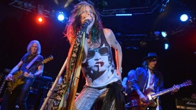 "From left, Tom Hamilton, Steven Tyler, and Joe Perry of Aerosmith perform at the Whisky A Go Go on Tuesday, April 8, 2014, in Los Angeles. Aerosmith announced their ""Let Rock Rule"" summer tour featuring Slash. (Photo by John Shearer/Invision/AP)"