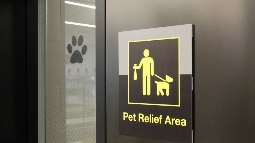 In this April 26, 2016 photo, a sign marks the new pet relief area opened April 4 in New york's JFK's Terminal 4.