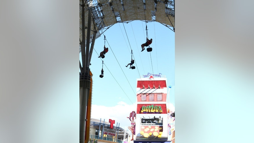 The slot machine themed zip line runs through historic Fremont Street.