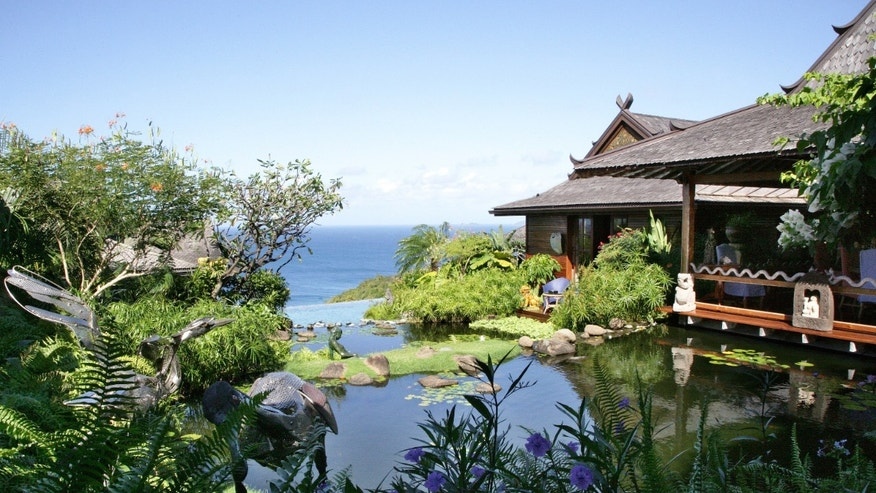 David Bowie's former Mustique property features elements from around the globe in a luxurious setting.