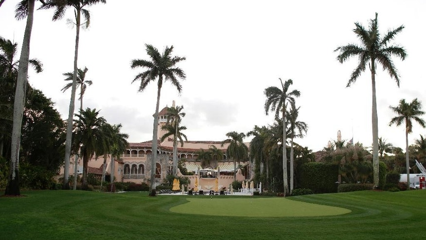 This Friday, March 11, 2016, photo, shows the Mar-A-Lago Club, owned by Republican presidential candidate Donald Trump, in Palm Beach, Fla. Trump has been trying for two decades through the Federal Aviation Administration and the courts to force departing airliners from Palm Beach International Airport to turn before reaching the historic and exclusive 17-acre estate, which is 2.5 miles east of the airport's primary runway. (AP Photo/Lynne Sladky)