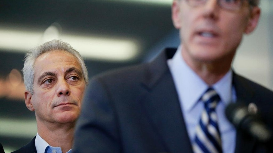 Chicago Mayor Rahm Emanuel, left, listens as Transportation Security Administration chief Peter Neffenger responds to a question related to the massive delays at airport security lines across the country Friday, May 20, 2016, in Chicago. (AP Photo/Charles Rex Arbogast)