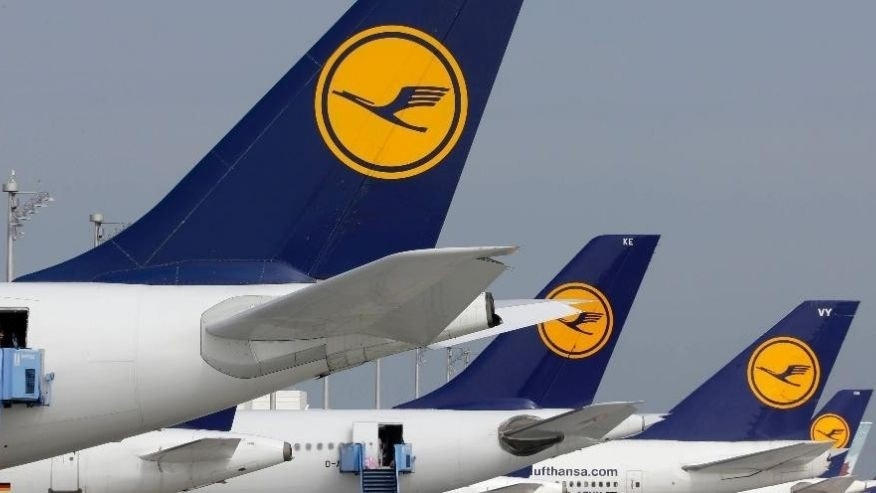 FILE - In this Sept. 10, 2014 file picture airport employees prepare aircrafts of the airliner Lufthansa at the airport during an eight-hour warning strike of Lufthansa pilots in Munich, southern Germany.