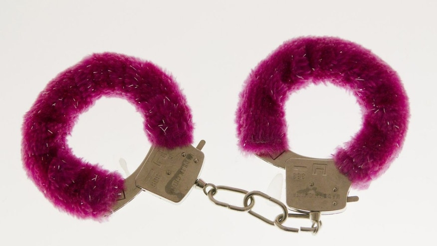 A pair of fuzzy handcuffs displayed at the original Museum of Broken Relationships in Zagreb, Croatia tossed aside by a former lover.