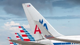 Miami, USA - July 30, 2014: The new and the old visual design of American Airlines together at Miami International Airport, Miami, Florida.
