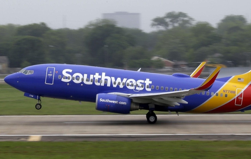 FILE- In this April 23, 2015, file photo, a Southwest Airlines jet takes off from a runway at Love Field in Dallas. Southwest Airlines reports financial results Thursday, April 21, 2016. (AP Photo/LM Otero, File) ORG XMIT: NYBZ404