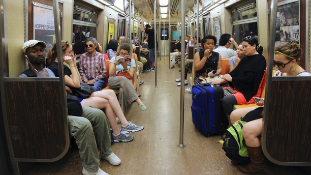 New York, USA - July 4, 2013: People ride Subway train in New York. With 1.67 billion annual rides, New York City Subway is the 7th busiest metro system in the world.