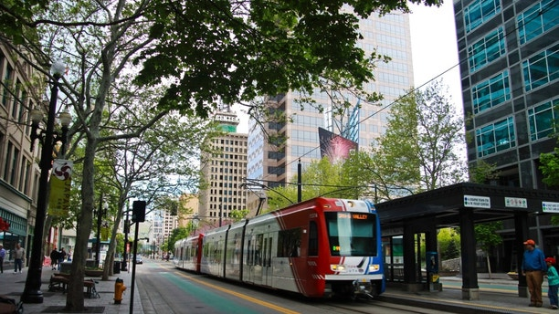 Salt Lake City, UT, USA - May 2, 2014: Main downtown area in Salt Lake City; in the background is the Zions Bank building in the foreground is a tram crossing. Salt Lake City is a very beautiful city.