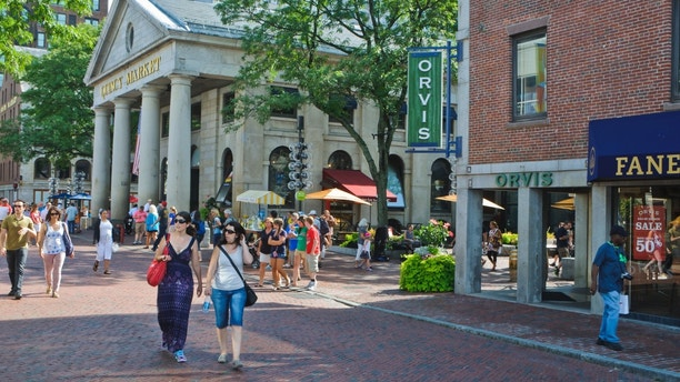 """""""Boston, Massachusetts, USA-August 7, 2012: Shoppers and tourists explore the outside and inside shops and restaurants of the historic Quincy Market complex on a beautiful August afternoon."""""""